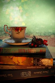 Rainy day, tea in a cup and books=perfection