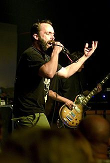 Neil Fallon and Tim Sult of Clutch - WRONG - that's bassist Tim Maines, not guitarist Tim Sult, behind Neil's beard. Saw the les paul shape and assumed w/o counting strings. My bad. (that's a sweet bass!)