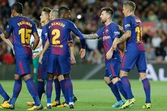 Barcelona's forward from Argentina Lionel Messi (2R) celebrates teammates after scoring during the Spanish league football match FC Barcelona against SD Eibar at the Camp Nou stadium in Barcelona on September 19, 2017. / AFP PHOTO / PAU BARRENA