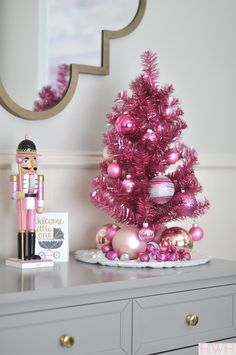 Festive holiday nursery with pink tinsel tree and pink nutcracker   Honey We're Home