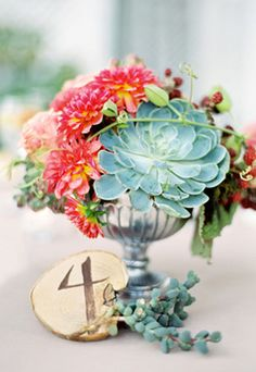 succulent floral arrangement centerpiece, would be very cool in different sizes!..