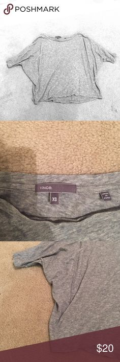 Vince doleman gray t-shirt Fitted at arms with doleman shape. Sits at waistline of pants. Perfect condition, rarely worn! Heather gray color. 100% cotton, very soft. Adorable with jeans or dressed up with a skirt! Vince Tops Tees - Short Sleeve