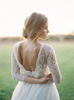 Backless dresses for the winter bride: http://www.stylemepretty.com/2015/11/30/backless-dresses-for-the-winter-bride/