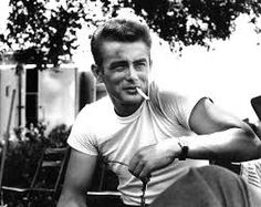 "James Dean was the face of the rebel look. This look consisted of tight whit t-shirts paired with rolled blue jeans. The outfit was sometimes topped off with a black leather jacket. The ""T-Birds"" in the movie Grease also epitomized this look."