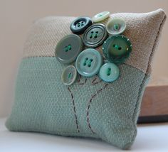 #pincushion with buttons....just make the buttons dark green, the bottom light green and the top blue and yellow