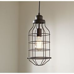 Trenton Pendant | Industrial chic at its finest, the caged design of the Trenton Pendant brings a little edge to your space.