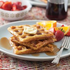 CRISP WAFFLES (Snug Hollow B) 1¼ cups old-fashioned oats  ½ cup unbleached all-purpose flour  ½ cup plain cornmeal  3 tablespoons light brown sugar  4 teaspoons baking powder  ¾ teaspoon salt  2 large eggs, lightly beaten  1 cup heavy whipping cream  1 cup whole milk  6 tablespoons melted butter