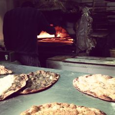 Artisan bakers prepare menouche (Lebanese pizza) for breakfast! Wild thyme zaatar, cheese or lahme bajeen (minced meat) for the choosing!