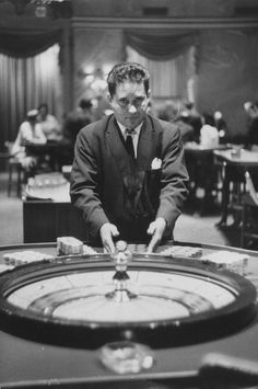 The Havana high life, before Castro - 1958 Roulette dealer at the National Casino.
