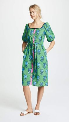 Rhode Resort Andrea Dress. A vibrant Rhode Resort dress that wears easily whether you are walking on the beach or shopping for souvenirs. The self-belt can cinch the waist for added definition or you can leave it flowing and easy.