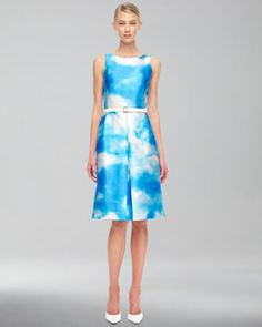 Michael Kors blue and white Cloud print dress with simple lines: fitted bodice, sleeveless, box-pleat a-line skirt.