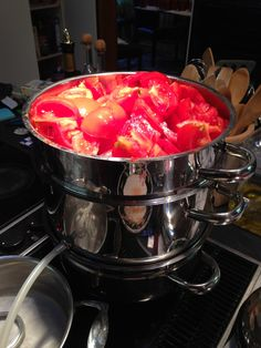 Steam juicer full of fresh tomatoes