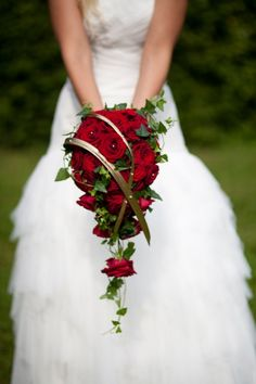 Fabulous cascade bouquet with red roses and ivy.