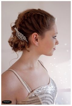 Beautiful and modern bridal updo with textured side French braid.