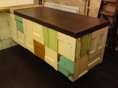 Wood patchwork counter made from old doors from stylingandsalvage.com.