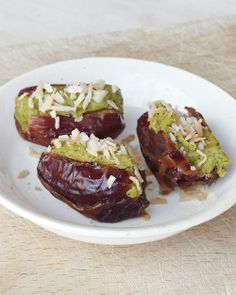 PISTACHIO-STUFFED DATES WITH COCONUT Whole Living, January/February January/February 2012.  Yield Makes 16  Serves 4  1/2 cup shelled pistachios  Pinch of coarse salt  16 dates, pitted  1 tablespoon toasted unsweetened shredded coconut  Directions    In a food processor, puree pistachios until a thick paste forms, about 5 minutes. Season with salt. Spoon mixture into dates. Top with coconut.