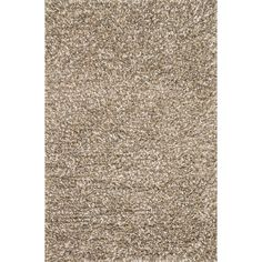 This Baxter Shag rug is an easygoing rug in a modern, bright hue blend. Crafted in India, this richly textured shag is hand-woven and will add texture and dimension to any interior decor.