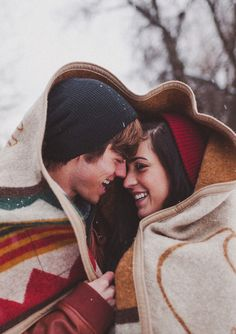 Cuddle under a blanket in the snow.
