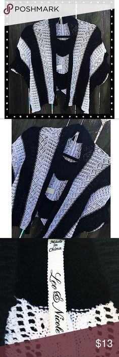 Beautiful Black & White Shrug Beautiful Shrug by Leo & Nicole in a size M. This piece is in EUC with no issues at all. Comfy, cozy...perfect, and goes with so many things, very versatile! Leo & Nicole Sweaters Shrugs & Ponchos