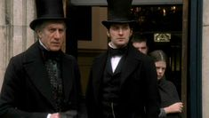 Brian Protheroe (Mr. Bell) & Richard Armitage (Mr. John Thornton) exit from the church after Mrs. Hale's funeral, in Episode 3 of North & South - North & South directed by Brian Percival (TV, Mini-Series, BBC, 2004) #elizabethgaskell