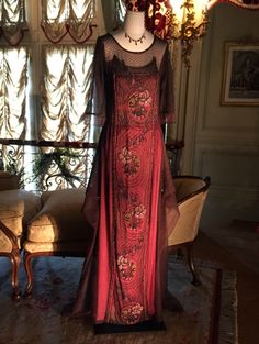 Cora Crawley's red silk evening gown on display in Dressing Downton exhibit