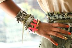 layering bracelets with mixed metals, colors and textures.  Love it!