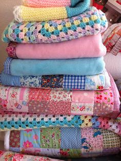 Snuggy stack of patchwork and crochet blankets