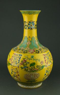 Chinese yellow ground porcelain vase, of bulbous form painted with auspicious objects. Bottom with six-characters Qianlong mark on base. H: 42 cm, D: 23 cm.