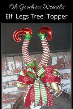 If you love Elf on the Shelf, and All Christmas Decor, Red, Green and White then look at these adorable Elf Legs Tree Topper. These Elf Legs give the impression of Santa's lil helper being stuck in the tree. Sure to bring cheer and laughter to all your family, friends and guests this Holiday Season. Christmas Tree Decorations, Christmas Wreaths, Holiday Decor, Elf Legs, Christmas Tree Inspiration, Trendy Tree, Support Small Business, In The Tree, Tree Toppers