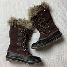 "Women's Sorel brown Joan Of Arctic cattail tall mid calf winter boots. Great condition- like new. Size women's 8. Picture 7 shows the only flaw- the clip for the lining is missing so it's not ""secure"". It doesn't effect the wear at all. Please review those photos. Everything else is NEW and perfect! Built with beautiful, waterproof full-grain leather and suede upper, super-soft faux fur lining, and insulated warmth to stay dry and comfortable even in the frostiest conditions. Waterproof suede up Sorel Boots, Winter Boots, Arctic, Faux Fur, Brown, Leather, Photos, How To Wear, Beautiful"
