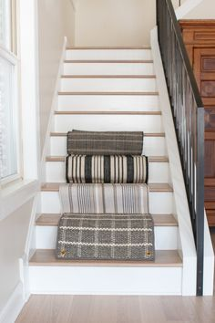 Our staircase was slipper so we decided to install a stair runner on them. Here's how we did this intermediate DIY project, including on a landing! Stairway To Heaven, Stair Runner Installation, Hardwood Stairs, Beautiful Stairs, Staircase Makeover, Painted Stairs, Stair Storage, Hallway Decorating, Staircase Design