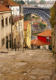 view of Porto in Portugal with the famous bridge over the river Douro from the famous architect Eiffel Visit Portugal, Spain And Portugal, Porto City, Portugal Travel Guide, Famous Bridges, Portuguese Culture, Douro, Draw On Photos, Famous Architects
