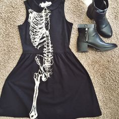 Skeleton Half Dress Brand new half skeleton dress very adorable and soft! Sleeveless and form fitting up top then flares out a little bit where the skirt starts. Skater dress style! Hot Topic Dresses Midi