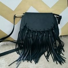 Best in Bags HP! Made of vegan leather.  One of the tassels is broken (as shown in pic) Bags Crossbody Bags