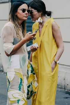Editorial Eclectic summer street style is what the NYC fashion girls are wearing - in 2017 its all about maximalist styling - pops of bold color, outfits with texture and mixing prints, high low outfit styling with elements of athleisure like white sneakers with dresses. Cue the statement sleeves, ruffled shirts, oversized everything, wide leg pants and culottes, and usually something Gucci. Dresses over jeans. Fashion blogger style.