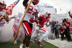 Nebraska Football Spring Game: Tommy Armstrong Jr. and Kieron Williams lead the team onto the field. By: BRENDAN SULLIVAN/THE WORLD-HERALD