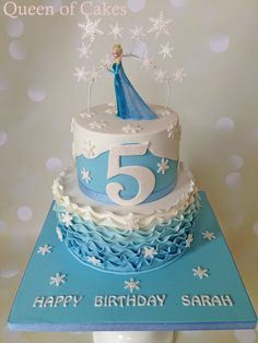 Frozen 2 tier birthday cake Ombre ruffles, glitter snowflakes and Elsa figure. By Queen of Cakes