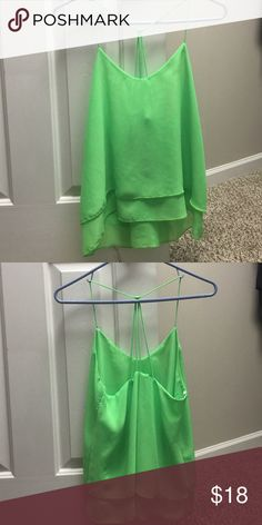 Green tank top True light U.S.A bright green tank top. Size M. The white straps that hang on hanger are cut out. They were annoying haha Tops Tank Tops