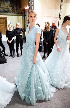 A model poses backstage before the Georges Hobeika Haute Couture Spring 2015 Show in Paris