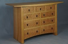 Custom Meander  9 drawer chest in cherry and curly cherry.