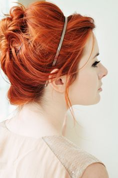 Love this vibrant shade of red hair and messy updo with headband on Jane from the style blog Sea of Shoes.