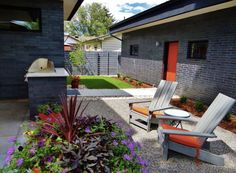 Lively hues define this outdoor seating area completed by Yard Works Design. Small Outdoor Spaces, Outdoor Seating Areas, Hardscape Design, Outdoor Living, Outdoor Decor, Building Exterior, Commercial Design, Garden Paths, Garden Design