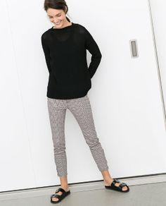 Image 1 of COMBINED PRINTED TROUSERS WITH FAUX LEATHER DETAILS from Zara