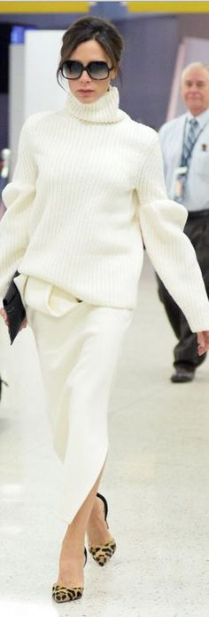Who made Victoria Beckham's white skirt, black sunglasses, and ribbed turtleneck sweater?