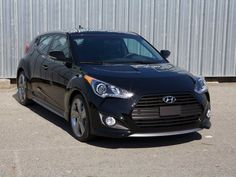 The 2013 Hyundai Veloster Turbo. It's our car. I love driving it.