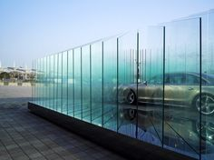 'AUDI haus' by atelier FCJZ at international racing circuit, shanghai the layers of glass are combined to create a translucent atmosphere lights from under the glass is refracted, creating thin, glowing edges Audi A8, Chinese Architecture, Facade Architecture, Pop Up, Fashion Window Display, Exhibition Display, Exhibition Stands, Glass Partition, Branding