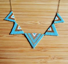 Hand woven triangle gold plated turquoise bib necklace with