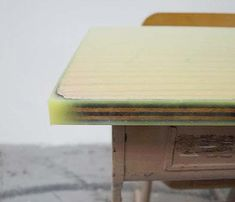 Japanese architecture firm Studio Schemata created flat surfaces on these vintage school desks by pouring color epoxy on the top board, which was uneven du