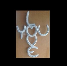 Love you cross made from horseshoes. by FireDogArt on Etsy, $50.00