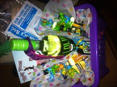 """21st birthday gift basket: Fun bottle of wine, name keychain/bottle keeper, minibottles of any and everything, and a CD of """"tipsy tunes"""" customized for the birthday person. In this case, I had alcohol-themed songs as well as songs we share when getting ready to go out. Just for fun, I stuck in a """"convenience bag"""" for vomit. Can't take this stuff TOO seriously! I packed it all in a reusable plastic basket."""